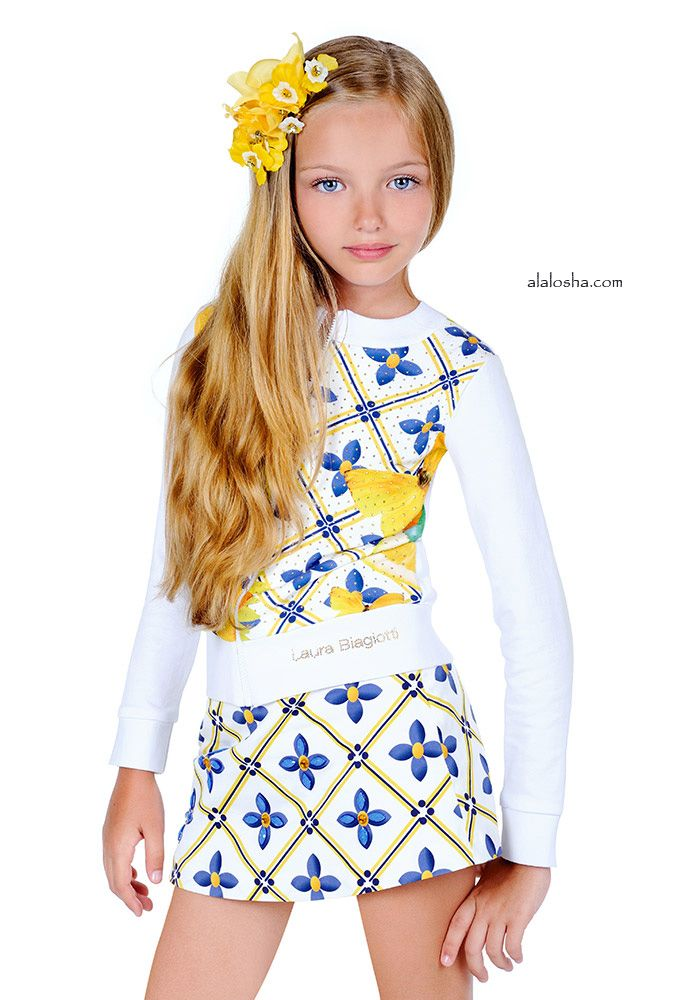 ALALOSHA: VOGUE ENFANTS: Set on the seashore between the dunes and the beach, against a clear blue summer sky, in the powerful yet soft light of sunset, the latest collection from Laura Biagiotti Dolls SS'15 convey calmness and harmony