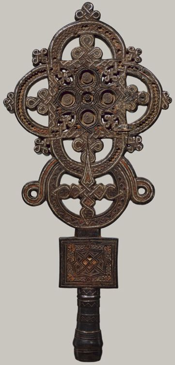 Wood and tin processional cross, ca. AD 1500, Ethiopia. In the Ethiopian church, the wooden cross is perceived as having been sanctified by Christ's blood, which conferred upon it infinite power to heal and to bless. - metmuseum.org