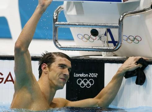 Michael Phelps celebrates after winning the 100-meter butterfly final for his 17th career Olympic gold and 21st medal overall.