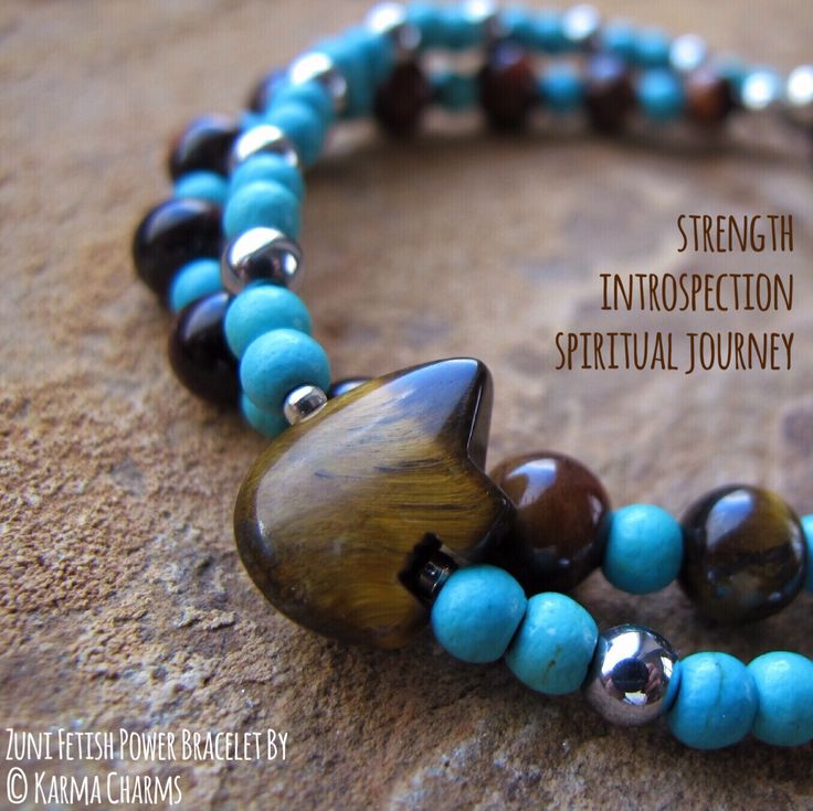 Zuni bear fetish made of natural Tiger Eye combined with 4mm Turqoise howlite, plated Hematite and 6mm Tiger's Eye. The Zuni fetish stands for strength, introspection, spiritual journey through life. Tiger's Eye is a stone of protection and it's both a grounding and uplifting crystal. It can be used to help balance the Solar Plexus Chakra. #bracelets #handmade #hematite #healingstones #handmadejewelry #zuni #fetish #oneofakind #power #turquois #tigereye #tigerseye #spiritual #journey
