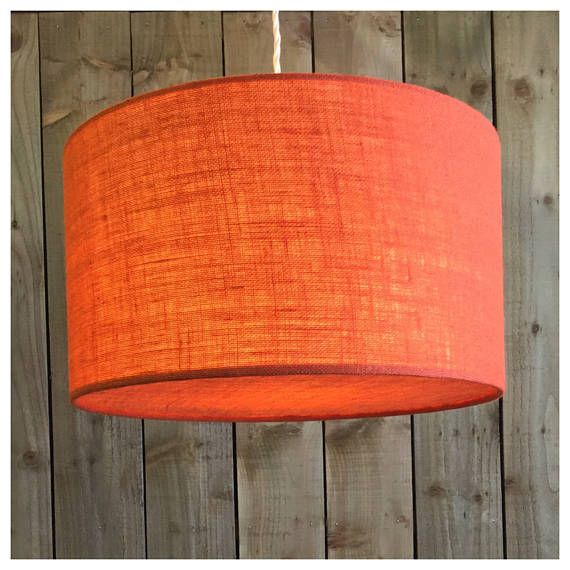 This stylish hessian lightshade & coordinating diffuser is handmade in our Bristol workshop from hessian fabric in orange ▪️Fabric - orange Hessian ▪️Made to order within 5 working days ▪️ Measures - Various Sizes ▪️Diffuser included. Diffusers are perfect for when shades are hung from high ceilings, they draw the eye to the shade design rather than the frame & bulbs ▪️European fitting (40mm) with a British adaptor (28mm) will fit all types of lampholder ▪️ Energy saving bulb recom...