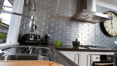 I like the pressed metal splashback in this kitchen