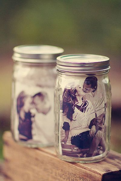 Pictures in Mason jars...cute for the wedding reception!
