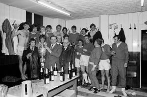 Everton manager Harry Catterick and his team celebrate winning the First Division championship in the dressing room at Goodison Park after a 2-0 victory over West Bromwich Albion, 1 April 1970. Back row (left-right): Howard Kendall, Colin Harvey, Alan Whittle, Tommy Wright, Sandy Brown, Jimmy Husband, Joe Royle, Johnny Morrisey, Keith Newton. Front row: Tommy Jackson, Roger Kenyon, Harry Catterick (Manager), unknown, unknown, Brian Labone (hidden), Alan Ball, Gordon West, unknown, John…