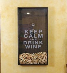 Wine Cork Holder   Easy to make: get a carpenter to cut you a nice box, get a piece of glass from the glass cutters, have them cut a hole, etch the glass yourself, and CHEERS to many great wines