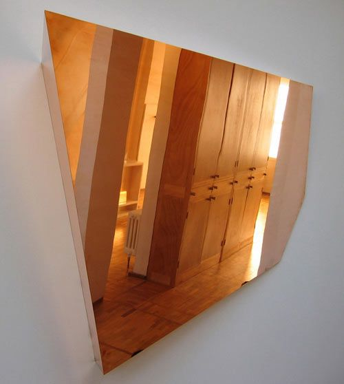 Copper mirrors from London-based designer Michael Anastassiades