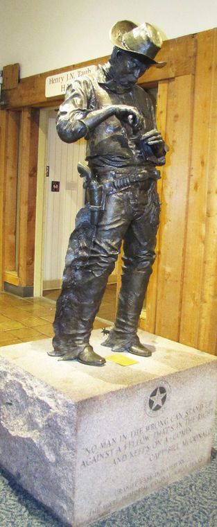 A bronze statue by Bob Sumners titled Old Ranger rolls a smoke at the Texas Ranger Museum and Hall of Fame in Waco, Texas.