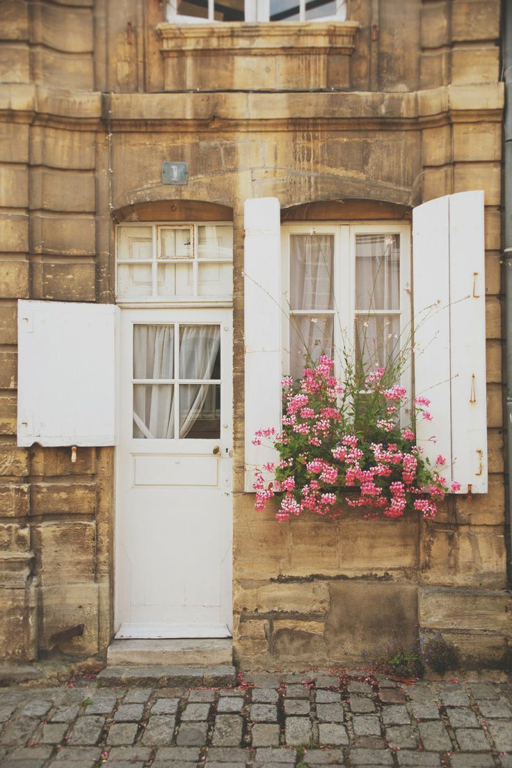 pretty door and window with protective shutters