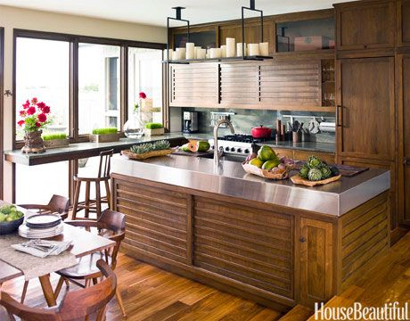 Compact and efficient: A slim pull-out pantry is just to the right of the refrigerator. Cabinetry designed by Marguerite Rodgers and fabricated by Pappajohn Woodworking. Pine Valley granite from Doyle Gerlach. Altar hanging light with electrified candles from Holly Hunt.   - HouseBeautiful.com