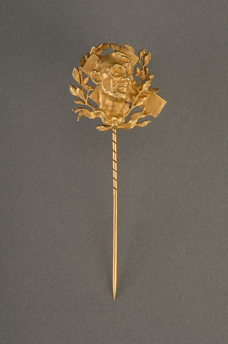 This gold mourning scarf pin with an image of Abraham Lincoln was among Mary Lincoln's possessions when she died.