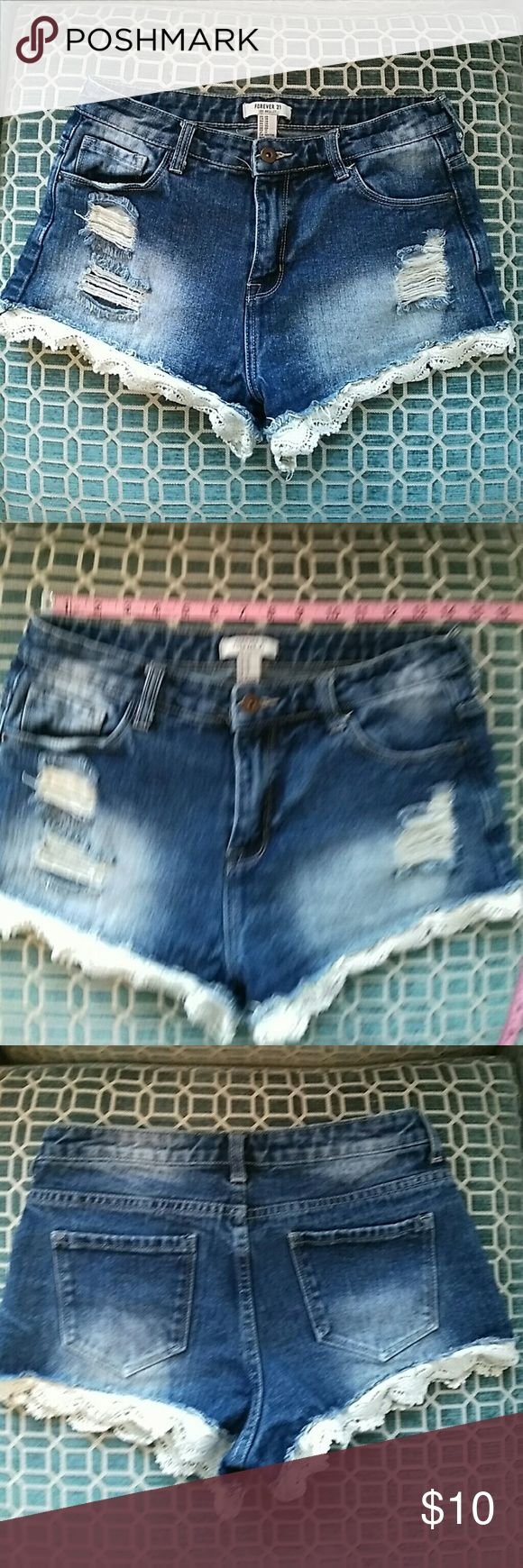 F21 lace trimmed shorts size 28 F21 lace trimmed shorts size 28. A few spots where the lace hasbtorn, shown in fourth picture. Forever 21 Shorts Jean Shorts