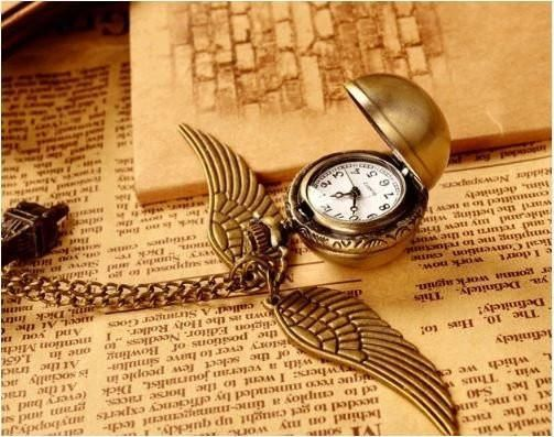 Harry Potter Golden Snitch Clock Necklace A gift for the true Harry Potter Fan!  Good Idea For The Christmas Season!  https://thegeeksdepot.com/collections/harry-potter/products/harry-potter-golden-snitch-quartz-necklace
