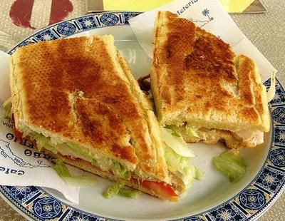 The Cubano sandwich started as Cuban cafeteria food for migrant workers in southern Florida. With travels back and forth, the sandwich got a footfold of popularity in Cuba itself.