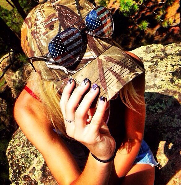 American flag sunglasses and camo hat