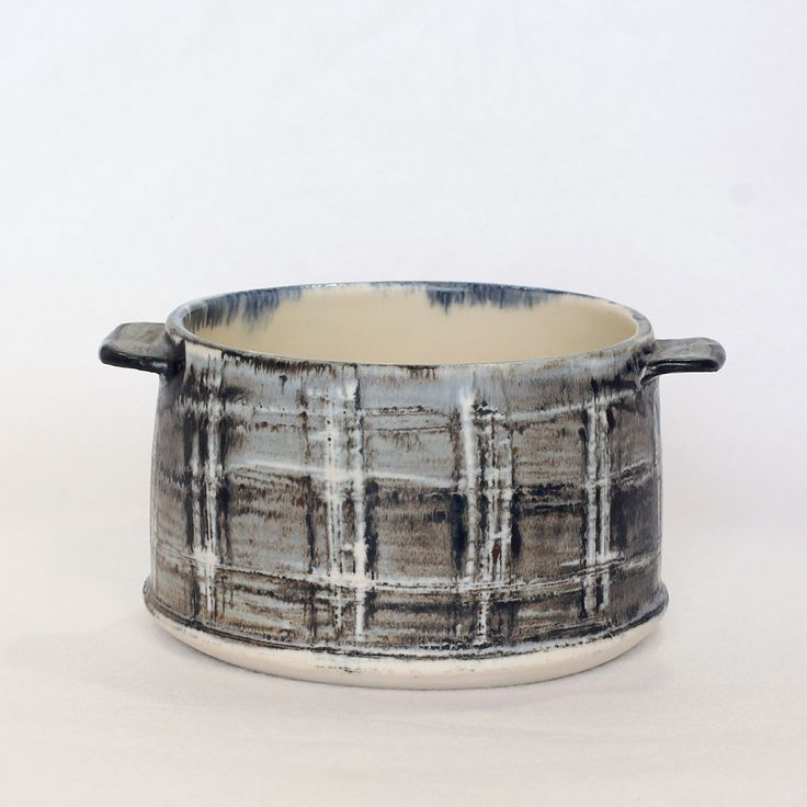 Small Talvi Bowl: A versatile bowl has little handles which makes it great for a serving dish. This range, by Creatively Occupied is inspired by Scandinavian winters with its snowy landscapes and silver birches. A mix of hand building, press moulding and throwing techniques are used by Michelle to create these functional, tactile and visually pleasing ceramics.