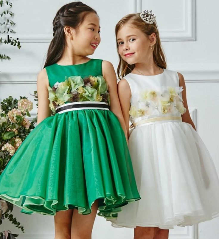 Cute Floral Dress-Made To Order - High Quality Sheer Round Neckline. Sleeveless Knee Length Infant Toddler Little & Big Girl 3D Floral Applique Party Dress. Available from 3 - 12 years. Material: Cotton, polyester fiber, satin, tulle mesh. Colors: Green Leaf & White. Please do compare your little girl's measurements with our size chart.