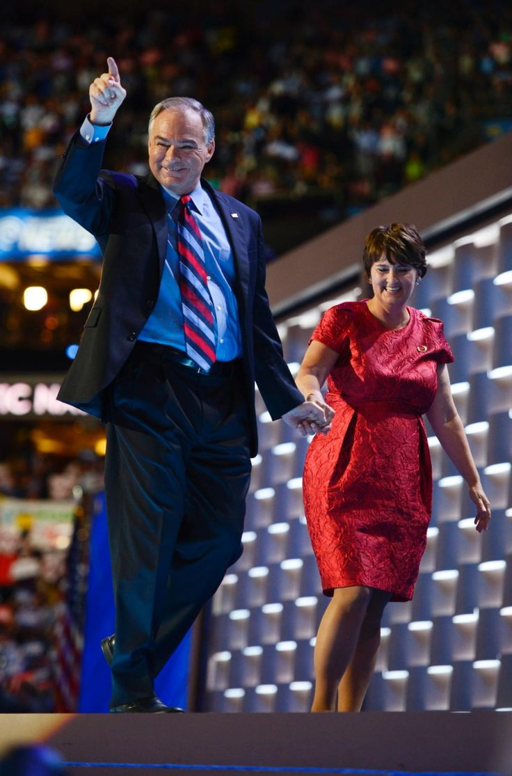 Sen. Tim Kaine and his wife, former Virginia Secretary of Education Anne Holton, hold hands as they leave the stage after Kaine's rousing speech at the Democratic National Convention Wednesday night.