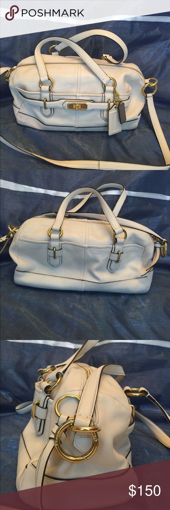 NWOT COACH SATCHEL PURSE Gorgeous ivory satchel purse  by Coach with gray lining and gold toned hardware. Purse has two outside storage pockets that snap shut and in the central compartment has a zippered pocket and two slip pockets. In like new condition has only been stored and never used. Coach Bags Satchels