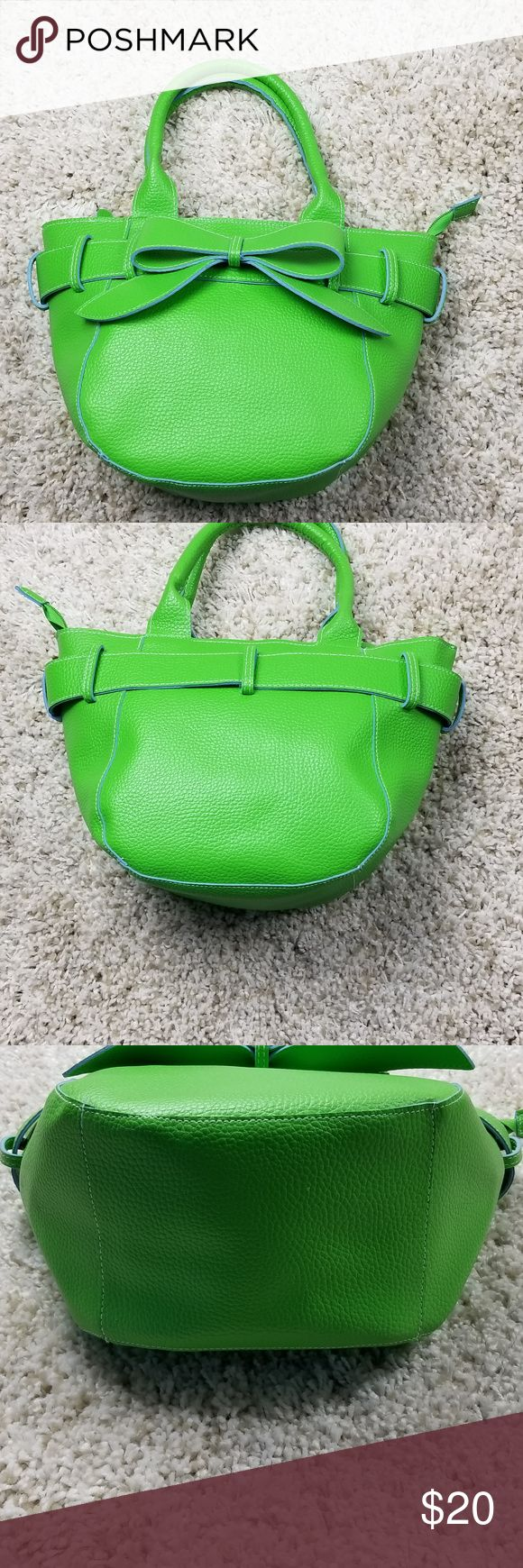 """MSC-Mainstreet-Collection-Green-Satchel MSC Mainstreet Collection Bow Textured Satchel with polka dot polyester lining.   In like new condition, no stains, rips or tears Lime Green MSC Mainstreet Collection Lime Green Women's Faux Leather Handbag Top zip closure Belt with belt loop design around the purse 2 inside open pockets 1 zip inside pocket Width – approx. 13""""   Height – approx. 9"""" Depth. Approx.  5"""" Handle drop – Approx. 6 ½"""" Mainstreet Collection Bags Satchels"""