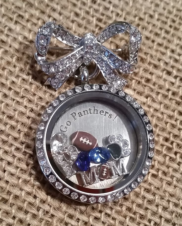 I'm a loud cheering, locket wearing, proud football Mom! Tell your story with Origami Owl order at www.suewatson.origamiowl.com