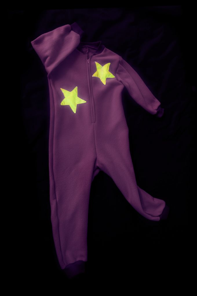 Purple onesie with GLOW in the DARK stars. Onesie + GLOW in the DARK = GLOWSIE = endless amount of fun for children.