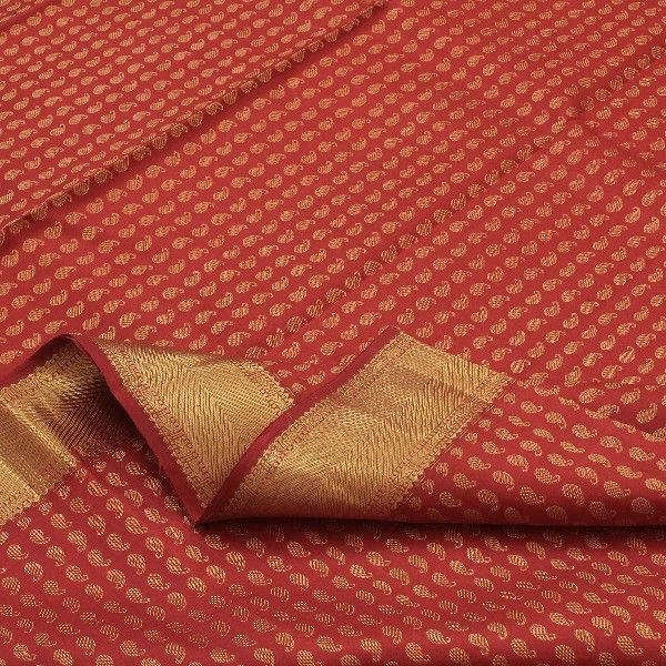 The sheen of arakku red #silk is enhanced with rows of inverted paisleys in gold all across the body of this handwoven #Kanjivaram. The gold border is inspired by the arrow pattern in different sizes. The sari appears to be a sea of molten gold with flashes of fiery maroon. The blazing arakku red pallu is a dazzling extravaganza, woven with geometric patterns in gold. For saris in this exotic colour, visit Sarangi. Code 390124089.
