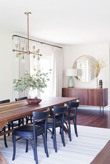 A Light, Bright, and California Cool Space// mid century sideboard, round mirror, eclectic dining room