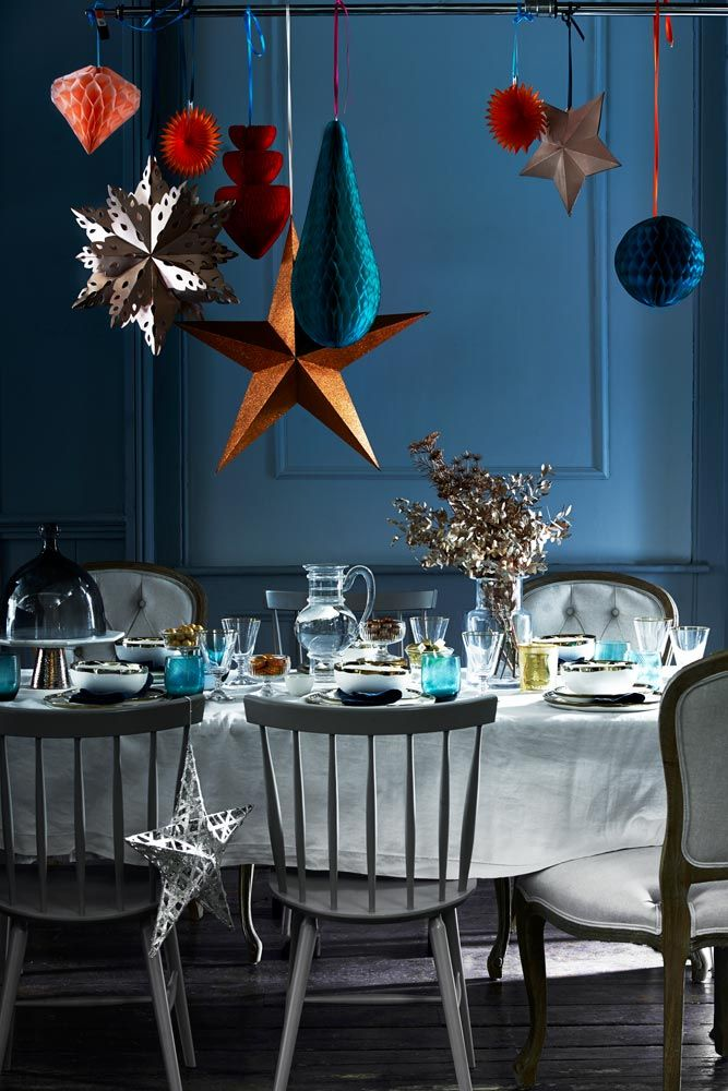 Hang laterns and stars over your Christmas dining table. For more like this, click the picture or see www.redonline.co.uk
