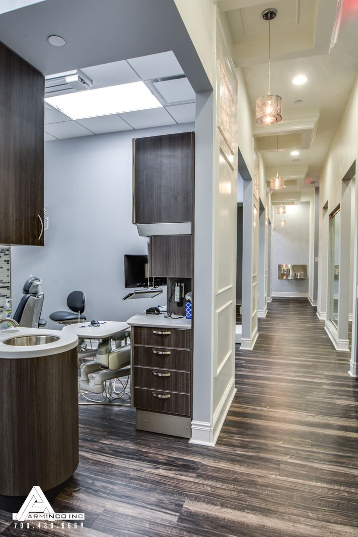 Paneled Hallways and Organic Light Fixtures. Dental Office Design by Arminco Inc.