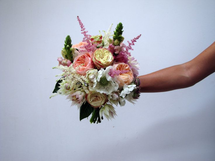 Bridal bouquet with Scabiosa, Astilbe, Roses, Seruria and Antirrhinum