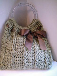 crochet purse pattern. i really like the purple ribbon bow one. i dont like the handles though. i would rather have crocheted handles that are somewhat long. long enough so you can put the purse over your shoulder.