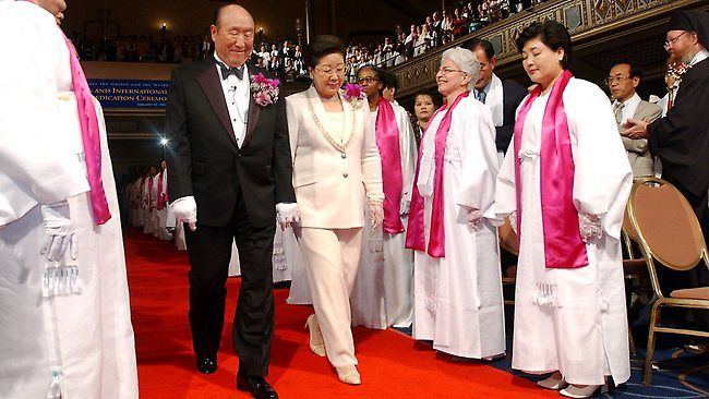 Couples from around the world participate in a mass wedding ceremony arranged by the Rev. Sun Myung Moon's Unification Church at Sun Moon University in Asan, south of Seoul, South Korea. Moon,