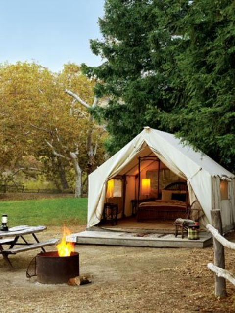 that's my kind of camping... really, I enjoy camping anyway, but how fun would it be to have a bed and full room tent!