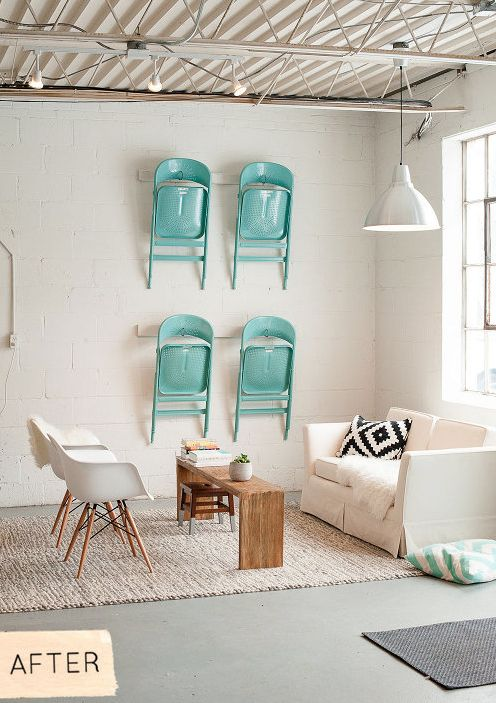Brightly colored folding chairs hang from the wall for additional seating // Studio or office space // via Design*Sponge