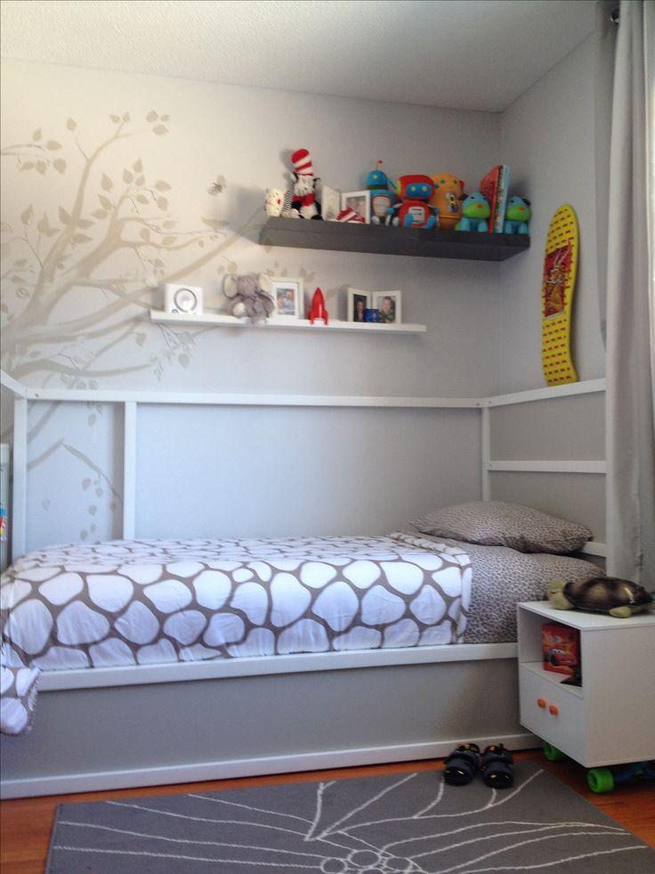 Ikea kura bed hack, hand painted tree, side table on skateboard hardware
