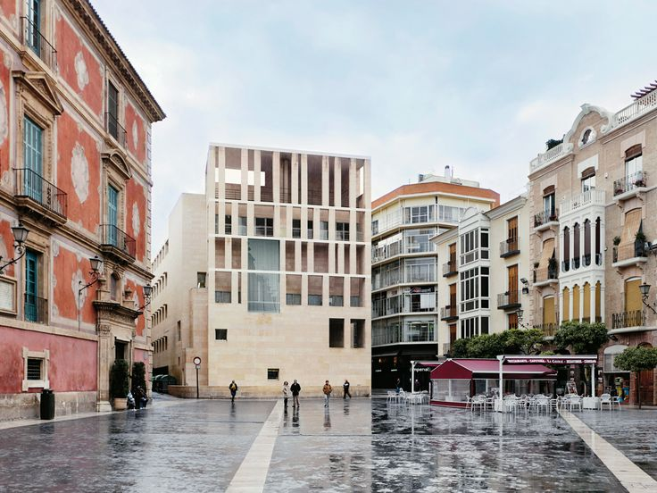 The facade of Murcia City Hall is not really the building, which is concealed behind it as if by a screen — but is the identity of the building. Moneo's enigmatic composition faces off against a Baroqu