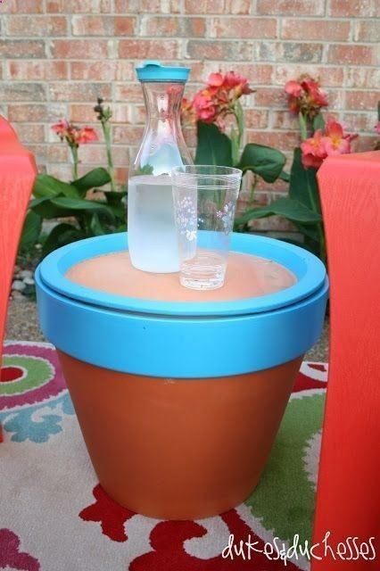 A big planter that serves as an outdoor end table by putting the ceramic dish on top instead of underneath: