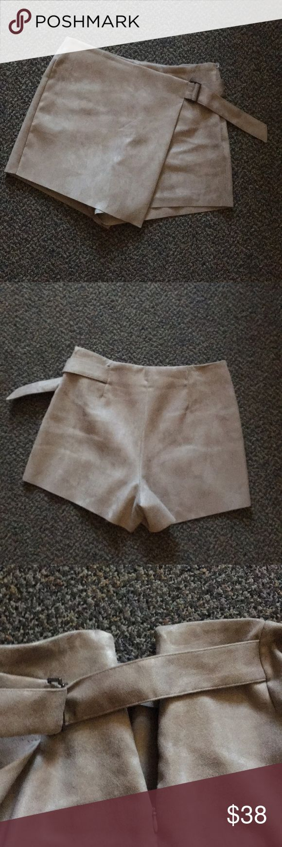 Beige Shorts Perfect condition suede beige shorts with asymmetric looking skirt front and belted, so cute, only worn once Zara Shorts Skorts