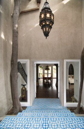 I love the blue tiled Moroccan entrance and the hanging lamp. And the tree trunk....