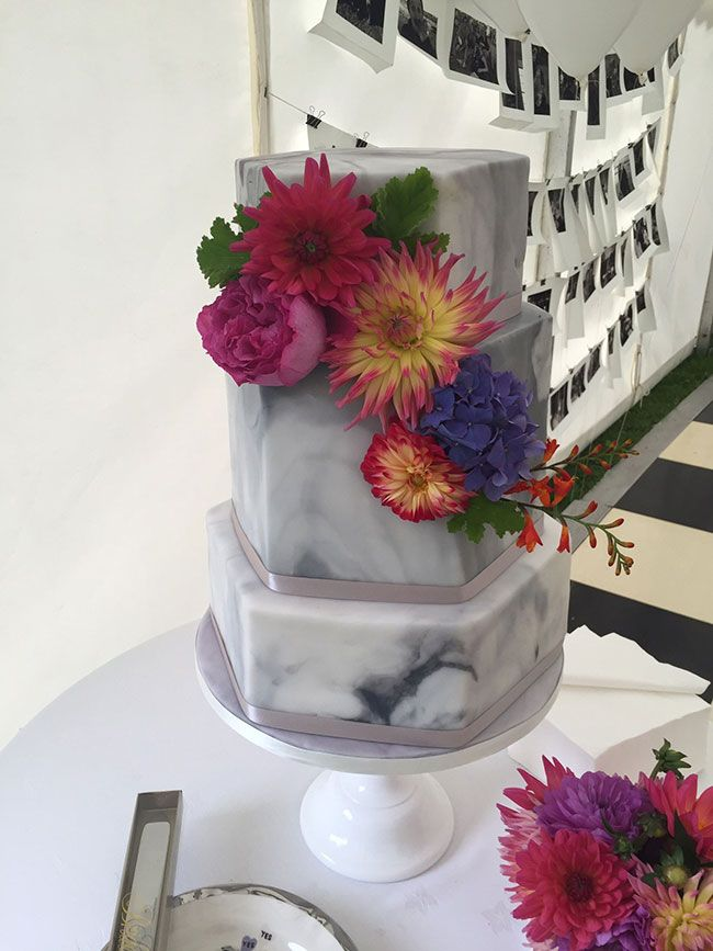 Keep it bright and bold by teaming marble with fresh flowers like this bespoke design from Emily's Mixing Bowl.