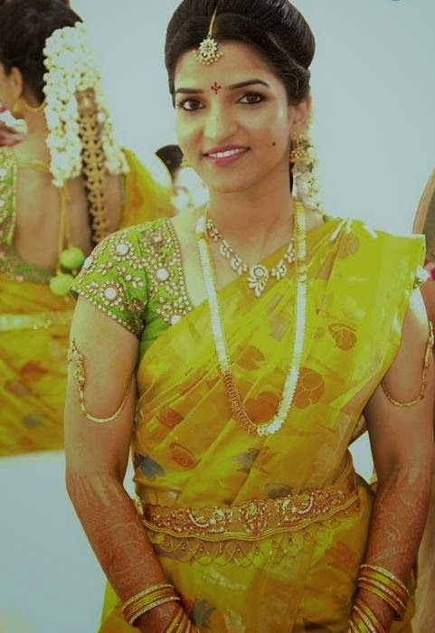 South Indian bride. Temple jewelry. Yellow silk kanchipuram sari. Braid with fresh flowers. Tamil bride. Telugu bride. Kannada bride. Hindu bride. Malayalee bride.