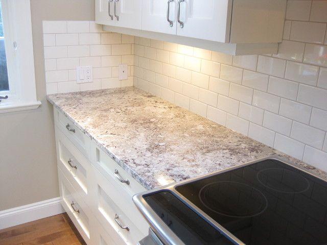 Alaskan white granite with white subway tile backsplash
