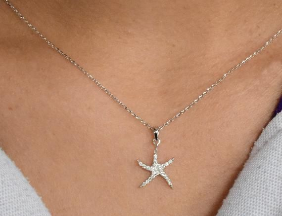 14k solid gold starfish pendant on 18 solid gold chain.