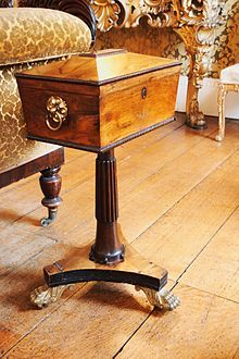A Nineteenth century tea caddy with its own stand
