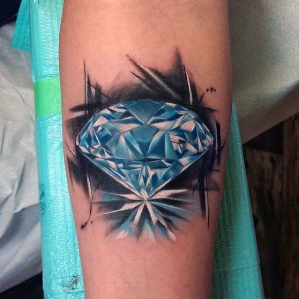 Little blue colored pure diamond tattoo on arm