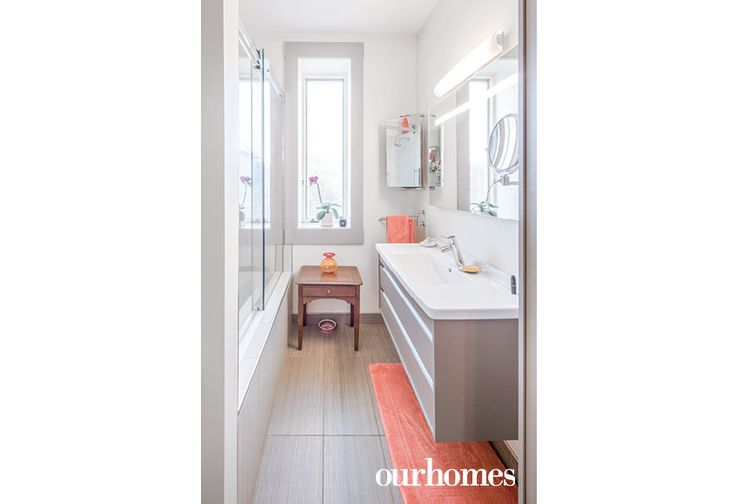 "The second floor main bathroom had also been renovated a few years ago by Sunter Carpentry. The floating vanity and tile floors had followed a similar neutral colour scheme with punches of vibrant orange.    See more of this home in ""Airy, Minimalist Rejuvenation of an 1890s Ottawa Home"" from OUR HOMES Ottawa Spring 2017:  http://www.ourhomes.ca/articles/build/article/airy-minimalist-rejuvenation-of-an-1890s-ottawa-home"
