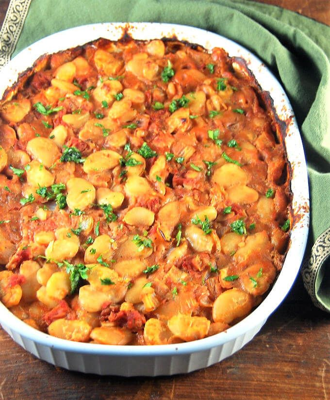 A delicious side dish of Greek style baked lima beans. The creamy beans are immersed in a bubbly, tangy-sweet tomato sauce with herbs.