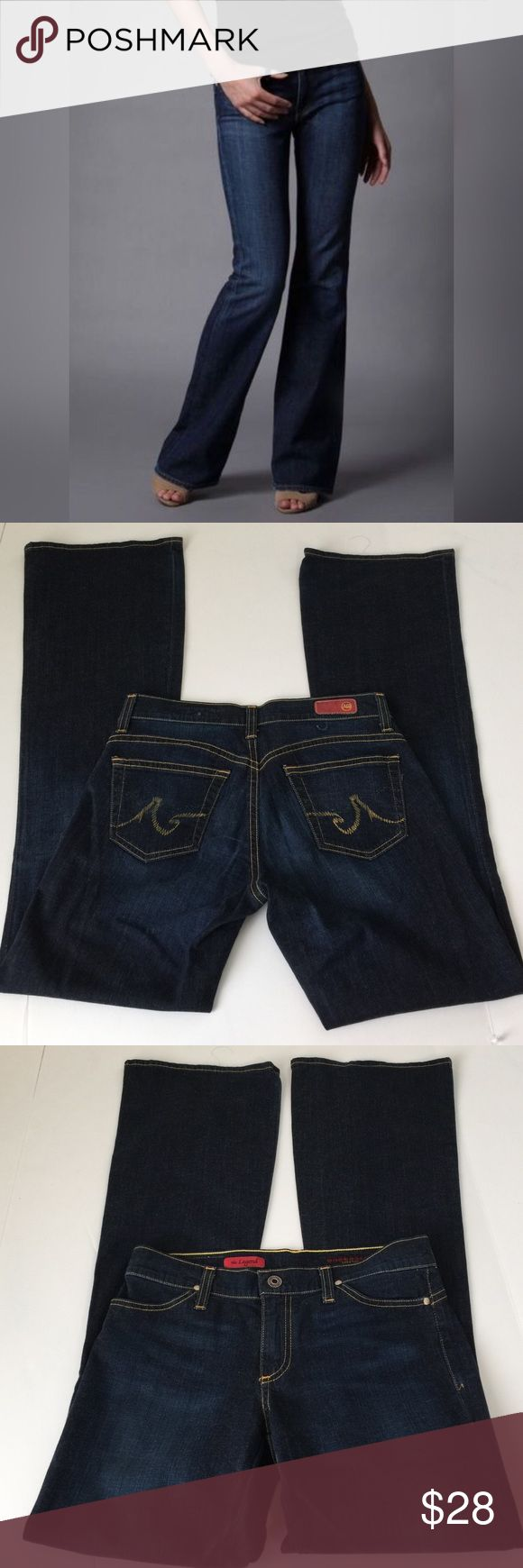 AG Adriano Goldshmied The Legend Flare Jeans, 27 AG Adriano Goldshmied The Legend Flare Jeans in size 27. Flat lay measure of the waist is 15. Rise is 8, inseam is 33, and leg opening is 10. Made from 95% cotton and 5% polyurethane.  Small area of distress under the red AG patch as seen in picture 2, but otherwise in very good condition. Please ask if you have any questions. AG Adriano Goldschmied Jeans Flare & Wide Leg