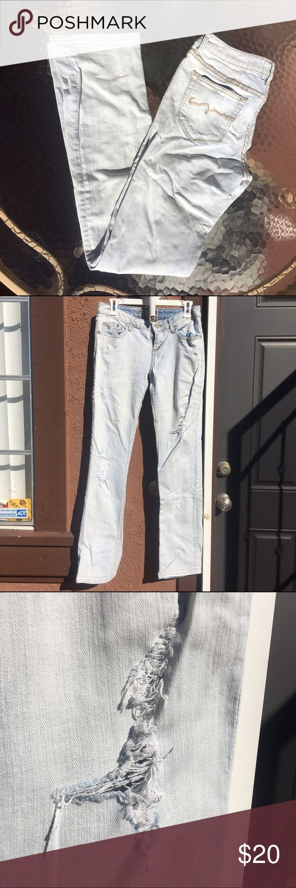 """American Rag Straight Cut Low Rise Jeans Light blue. Rise 7"""", inseam 32"""". Lightly distressed on the back pockets and the upper front of the jeans. Larger distressed sections on lower left thigh and right knee. 98% cotton, 2% spandex. American Rag Jeans Straight Leg"""