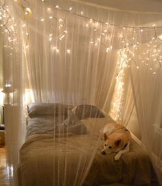 Create a magical cocoon around your bed with a gauzy and glittering canopy. Simply hang sheer drapery panels on wire rope threaded through eye hooks in the ceiling and accent with strings of cascading holiday lights. Get the tutorial from Olive and Love